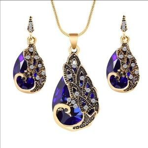 Gold plated peacock earrings and necklace set